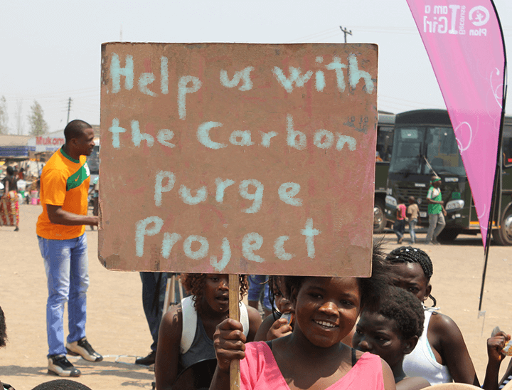 African Children Holding Carbon Purge Sign